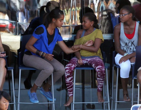 Michelle Obama and daughters Sasha and Malia attend the US Open in New York