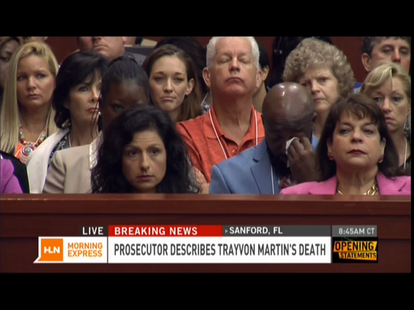 Tracy Martin wiping away tears as Trayvon's death is recounted in Zimmerman openings.