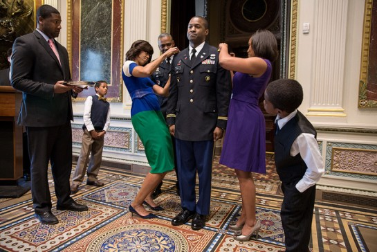 First Lady Michelle Obama participates in a promotion ceremony for White House Fellow Archie Bates in the Eisenhower Executive Office Building, May 3, 2013. Bates was promoted to the rank of Lieutenant Colonel. Standing with them, from left, is Jason Washington, a White House Fellow; son Archie Bates IV; Brigadier General Barrye Price; wife Jaquetta Bates; and son Isaiah Bates.  ---Official White House Photo by Chuck Kennedy
