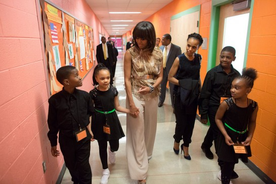 First lady Michelle Obama and Kerry Washington walk with students at Savoy Elementary School in Washington, D.C., May 24, 2013. Savoy is one of eight schools selected for the President's Committee on the Arts and the Humanities (PCAH) Turnaround Arts Initiative.  ----Official White House Photo by Lawrence Jackson