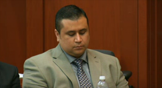 Zimmerman holds head down after hearing 911 call of Trayvon screams