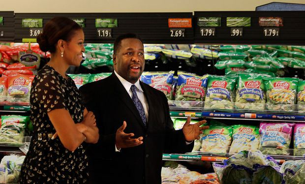 First Lady Michelle Obama talks with Wendell Pierce at Sterling Farms grocery store in Marrero. She visited the grocery story to continue highlighting a theme of healthy food access after she addressed the 2013 National Council of La Raza Conference at the Ernest N. Morial Convention Center in New Orleans. Pierce serves on the board of the Alliance for a Healthier Generation, and opened the grocery store to expand the healthy, affordable options available in a neighborhood affected by Hurricane Katrina.