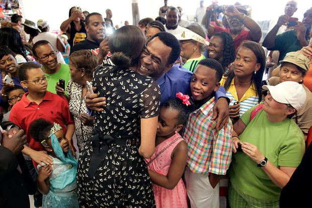 a hug from Beasts of the Southern Wild actor Dwight Henry at Sterling Farms grocery store