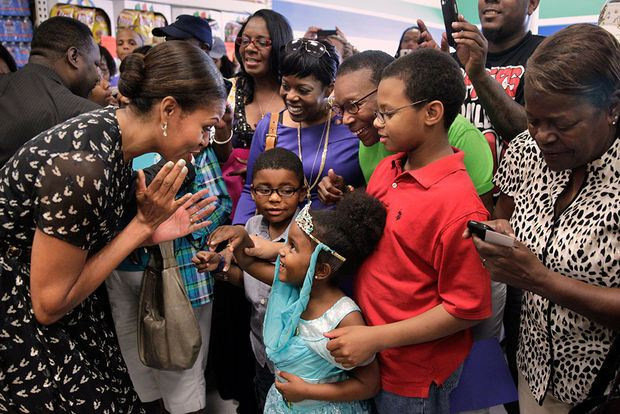 Naomi Bouie, a 5-year-old Uptown resident wearing her blue Princess Jasmine costume modeled after the character from the animated movie Aladdin, gave Obama a prolonged hug as she continued greeting other shoppers. Naomi's mother and grandmother said afterward that they told her about Obama's health and fitness campaign, which is called, Let's Move!, and that the girl dutifully told the first lady that she loves broccoli….