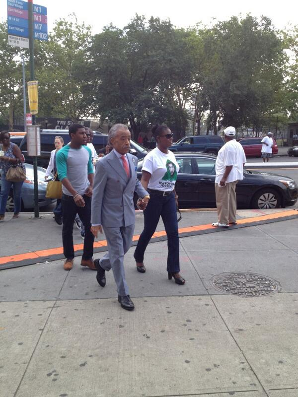 Sybrina Fulton arrives with Al Sharpton at his headquarters in Harlem.