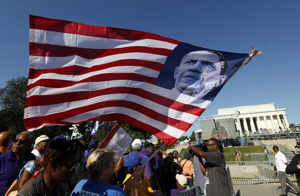 MOW- A marcher holds a U.S. flag bearing the image of President Obama, Washington, August 24