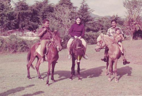 Curious child- photo of Barack Obama, with his mother, his adoptive father, and his half-sister Maya, circa 1971.
