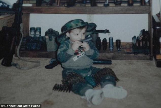 Adam Lanza- baby gnawing on gun
