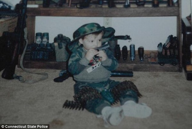 Adam Lanza- baby gnawing on gun
