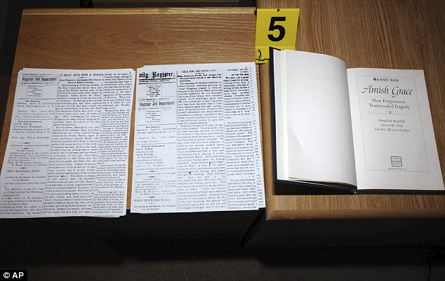 Adam Lanza- newspaper clippings of Amish school shooting