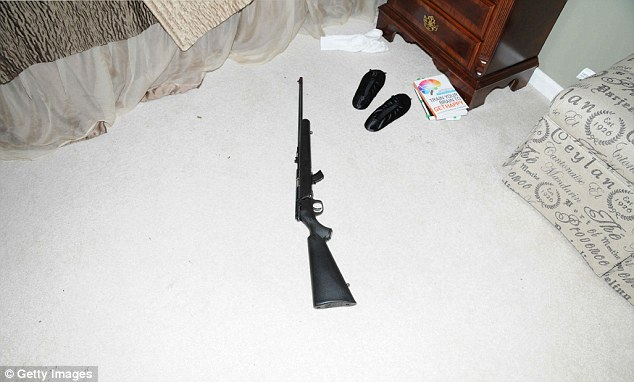 Adam Lanza- rifle on floor