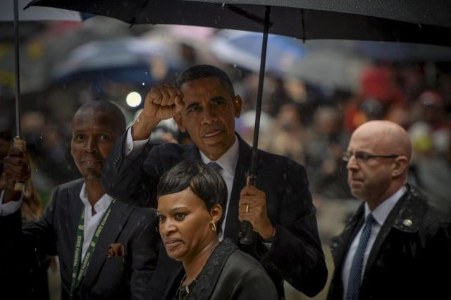 Barack Obama showing a sign of solidarity with People of South Africa