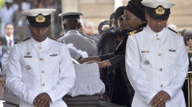 Graca Machel bids farewell to her husband, Nelson Mandela, whose body lay in state Wednesday at the Union Buildings in Pretoria.
