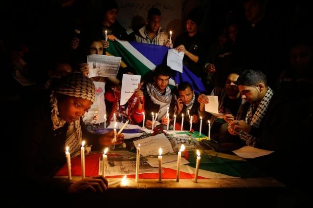Mandela Mourning- Palestinians attend a candlelight vigil for Mandela in Gaza City on Sunday