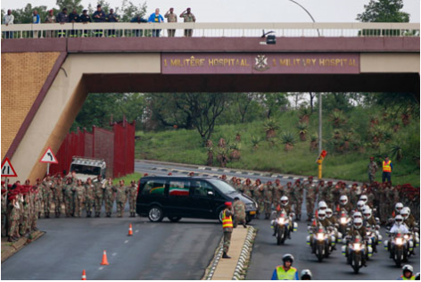 Mandela's funeral cortege proceeds through Pretoria