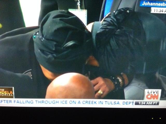 Winnie Mandela embracing Graca Machel.