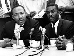 Civil rights leaders Rev. Martin Luther King Jr., left, Rev. Fred Shuttlesworth, center, and Rev. Ralph Abernathy hold a news conference in Birmingham, Ala
