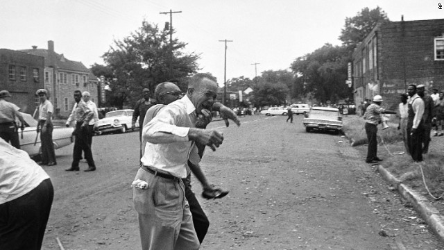 Dr. King-grieving relative is led away from the site of the 16th Street Baptist Church bombing in Birmingham, Alabama, on September 15, 1963.