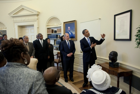 President Barack Obama views the Emancipation Proclamation with a small group of African American seniors, their grandchildren and some children from the Washington DC area, in the Oval Office. This copy of the Emancipation Proclamation, which is on loan from the Smithsonian Institution, was hung on the wall of the Oval Office today and will be exhibited for six months, before being moved to the Lincoln Bedroom where the original Proclamation was signed by Abraham Lincoln on Jan. 1, 1863, January 18, 2010. (Official White House Photo by Pete Souza)