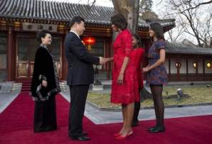 Flotus China Tour- First lady Michelle Obama, third from right, shakes hand with Chinese President Xi Jinping, second from left, as Michelle Obama's daughters Malia, right, Sasha, second right, Peng Liyuan, wife of Xi Jinping,