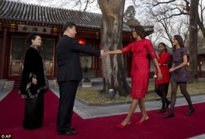 Flotus China Tour- Formal welcome-She posed for photos alongside her Chinese counterpart, Mrs Peng - with whom she is building a budding relationship. Above, Mrs Obama shakes hands with Xi, while her daughters walk behind her