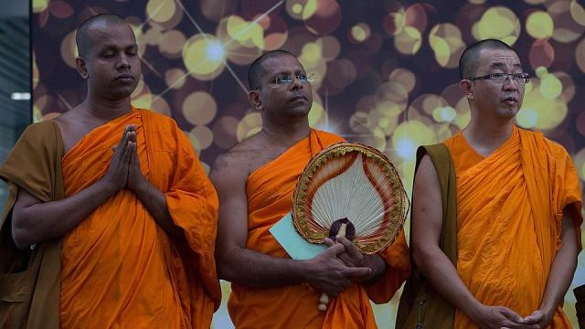 Malaysia Airlines-Buddist monks offer special prayers for passengers aboard the missing Malaysia flight MH370 at the Kuala Lumpur International Airport in Sepang on March 9th 2014 Photop AFP