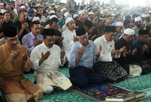 Malaysian Prime Minister Najib Razak, 3rd from left, attends a special prayer at a mosque near Kuala Lumpur International Airport.