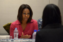 US Embassy-First Lady Michelle Obama talks with a group of students and teachers at the US embassy in Beijing, on March 23, 2014