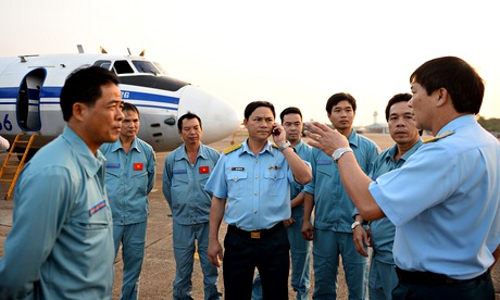 Malaysian airlines search: Vietnamese air force crew stand in front of a plane