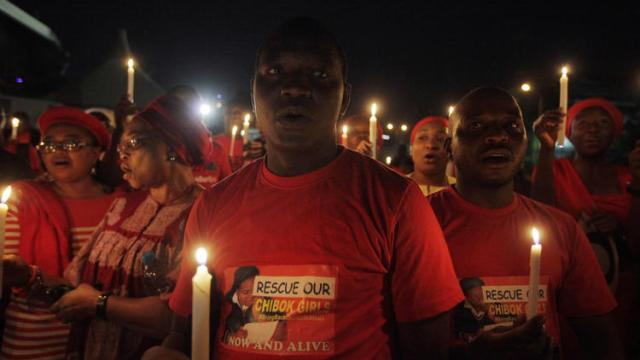 Demonstrators in the Nigerian capital, Abuja, hold a candlelight vigil this week to mark a month of captivity for scores of kidnapped schoolgirls. (Sunday Alamba - Associated Press)