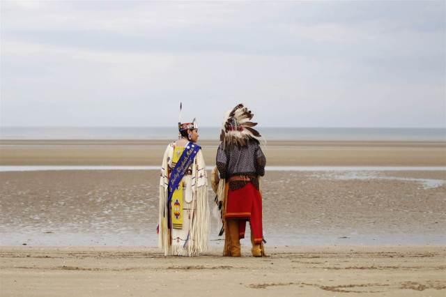 Descendants of Comanche Indian soldiers pray on Utah Beach on June 9, in Sainte-Marie-du-Mont, northwestern France.