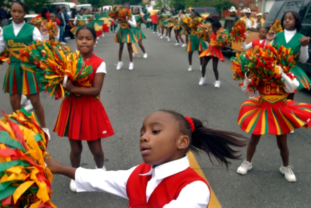 DENVER, CO, JUNE ,19, 2004 - The Juneteenth parade, beginning at Fuller Park in Denver. Chaunice Jones, 6, and the rest of the members of the cheering squad from the Syrian Temple NO. 49 from Denver, lead the way as the parade begins.(Denv