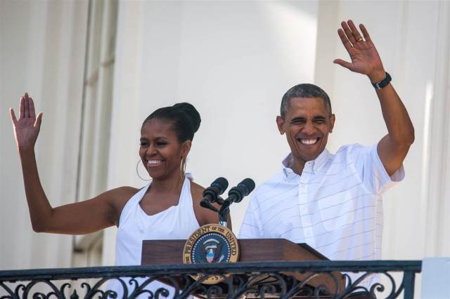 Barack & Michelle waves to veterans and their familes as they host Independence Day barbecue on the South Lawn of the White House