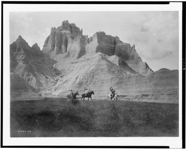 Edward S Curtis Collection- Entering the Bad Lands. Three Sioux Indians on horseback. 1905