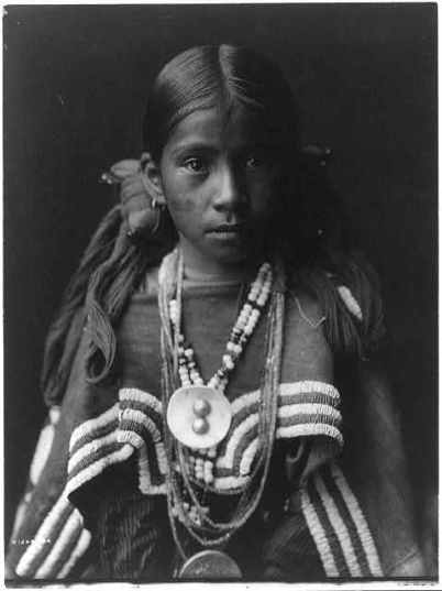 Edward S. Curtis Collection= Jicarilla girl in feast dress
