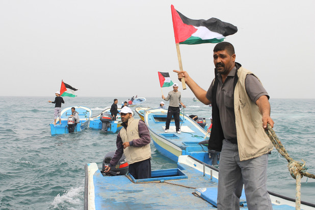 Fisherman and activist Zakaria Baker, right, says that Israel's crimes in Gaza's waters are routine.