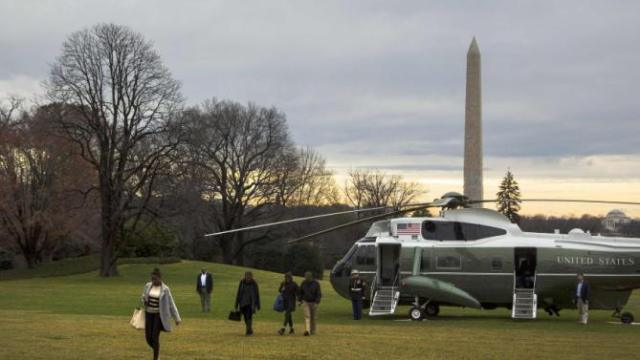 Obama arrives with his family via Marine One helicopter to the South Lawn of the White House