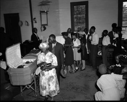 Mourners walking past the open coffin of lynching victims George W. Dorsey and his sister Dorothy Dorsey Malcom, Mount Perry Baptist Church, Bishop, Georgia, July 28, 1946