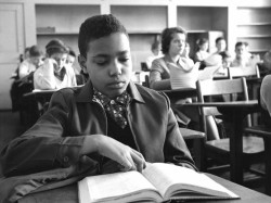"In the classroom: James ""Skip"" Turner Jr. sits in class at Norview Junior High School. White students sat in the rear of the classroom, leaving several empty chairs to separate them from the African American students. (Virginian-Pilot file photo)"