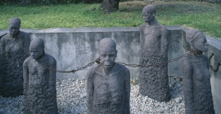 These statues of chained slaves in Tanzania stand as a memorial to the old slave market.