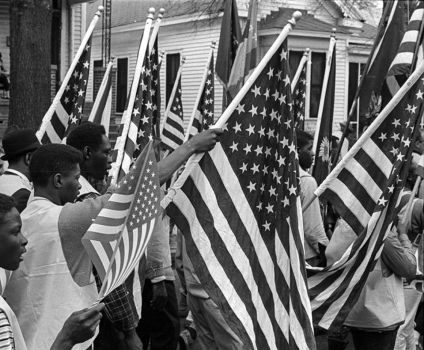 Selma marchers carrying the American Flag