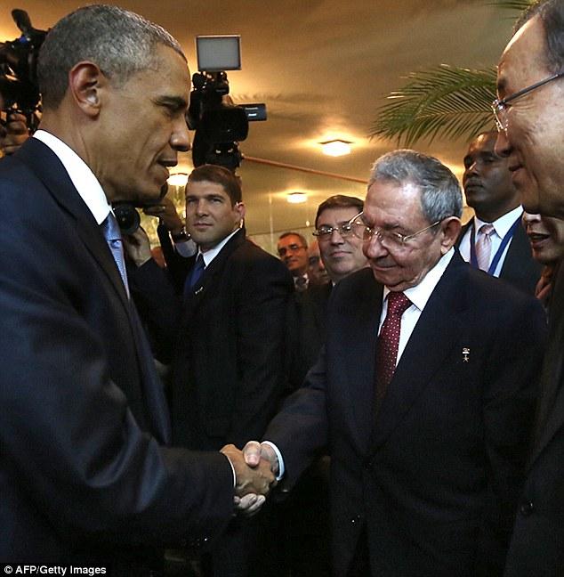 2771FC4700000578-3035113-Warmth_President_Barack_Obama_and_Cuban_President_Raul_Castro_sh-a-3_1428776046292