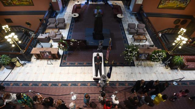 South Carolina Highway Patrol honor guard stand over Sen. Clementa Pinckney's body as members of the public file past in the Statehouse, Wednesday, June 24, 2015, in Columbia, S.C. President Barack Obama is scheduled to deliver the eulogy at Pinckney's funeral Friday morning at the College of Charleston. (AP Photo/Rainier Ehrhardt)