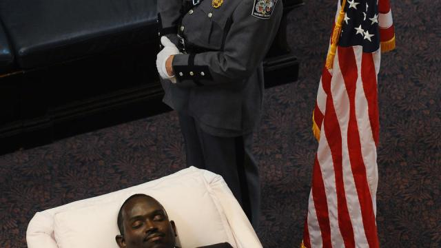 A South Carolina Highway Patrol honor guard stands over Sen. Clementa Pinckney's body during a public viewing in the Statehouse, Wednesday, June 24, 2015, in Columbia, S.C.  President Barack Obama is scheduled to deliver the eulogy at Pinckney's funeral Friday morning at the College of Charleston. (AP Photo/Rainier Ehrhardt)