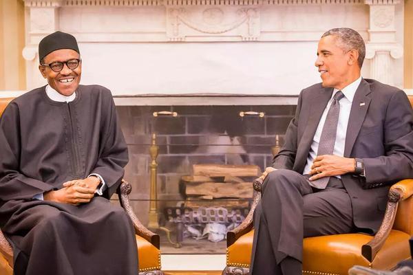 Buhari laughs with Obama