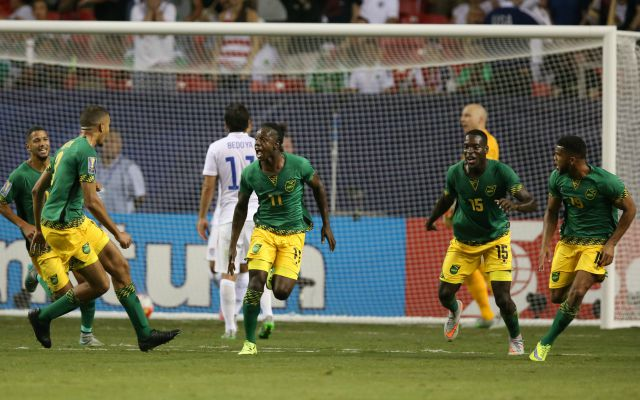 Jul 22, 2015; Atlanta, GA, USA; Jamaica forward Darren Mattocks (11) celebrates after scoring a goal with  Je-Vaughn Watson (15) and Michael Hector (3) in the first half against the United States during the CONCACAF Gold Cup semifinal match at Georgia Dome. Mandatory Credit: Jason Getz-USA TODAY Sports