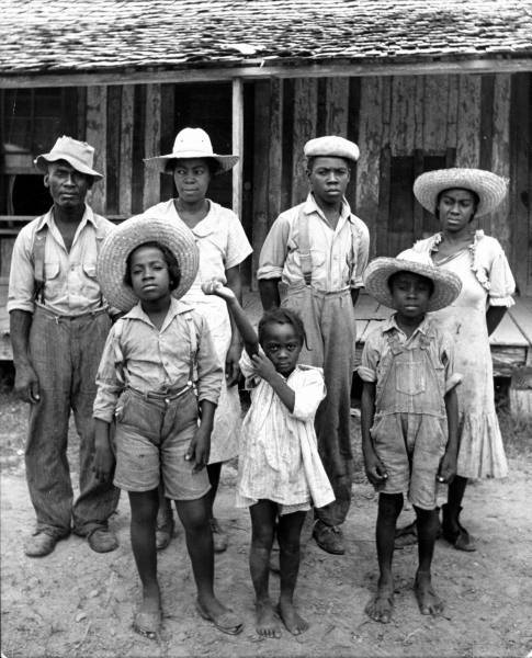 1936- Sharecropper family in front of their home in Scott, Mississippi