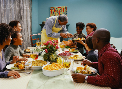 Family Eating Thanksgiving Dinner --- Image by © Larry Williams/CORBIS