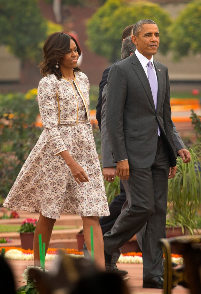 U.S. President Barack Obama, along with first lady Michelle Obama arrives for a  reception hosted by Indian President Pranab Mukherjee on Indiaís Republic Day at the presidential palace in New Delhi, India, Monday, Jan. 26, 2015. Obama on Monday took in a grand display of Indian military hardware, marching bands and elaborately dressed camels, becoming the first American leader to be honored as chief guest at India's annual Republic Day festivities. (AP Photo /Manish Swarup)  ORG XMIT: DEL185