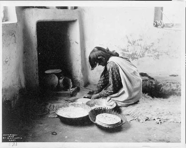 Native America Zuni woman making bread.